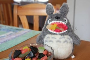 Totoro eats candies by Awesome-Prussia15