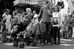 Hands full with beer and babies by steppeland