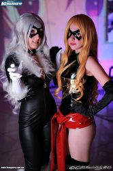 Black cat and miss marvel by Sakurith
