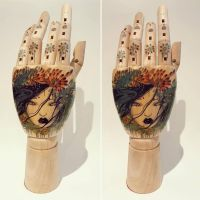 Eva wooden hand by lalalandofclouds
