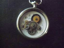 Small timekeepers clockwork charm by TheJadedRaven