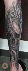Bloody skull biomech tat healed by 2Face-Tattoo