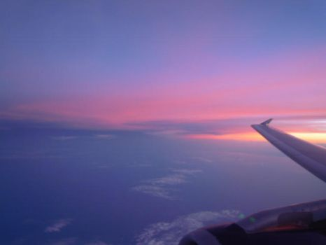 beautiful sunset out of plane window by pennyloves2jump