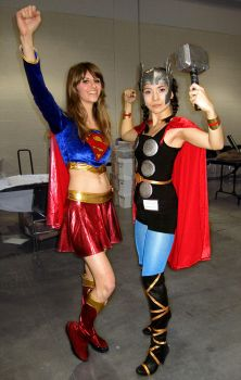 Supergirl and Thor by mysteryming