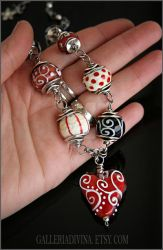 Red heart lampwork necklace by Faeriedivine