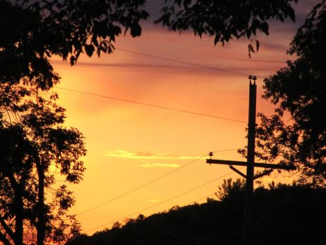 Telephone pole sunrise by TheSilverSound