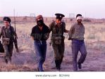 Russian-soldiers-escort-captured-and-blindfolded-t by GMcity
