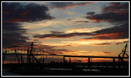 Sunset Over the Soo Locks by quietwiser89