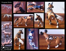 Painted dog sculpture by Painted-Shadow