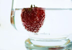 floating strawberry by hmm---ola