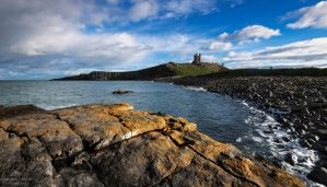 Dunstanburgh dominates by LordLJCornellPhotos