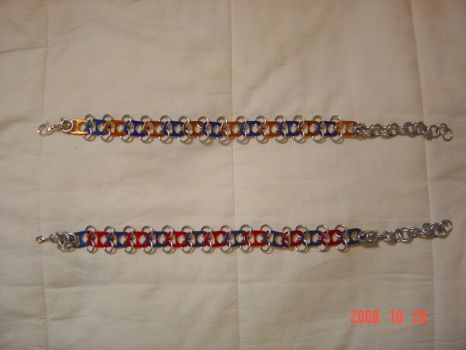 a pair of chain mail chokers by PsychofoxR