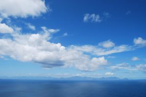 Blue Sky with Clouds by CompassLogicStock