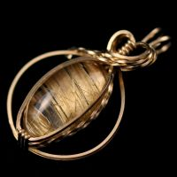 Rutilated Quartz Halo Pendant by innerdiameter