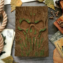 Skull Grimoire covered in moss by MilleCuirs