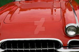 The Hood Of A Classic Red Sports Car by morrbyte