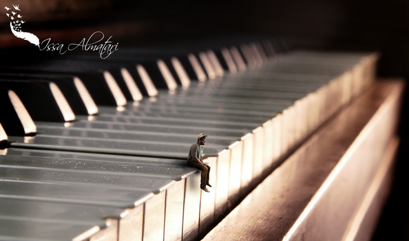 Miniature man on piano by issa885