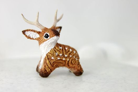 Gold deer totem by hontor