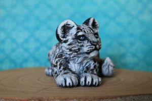 Snow leopard kitten by thai-binturong