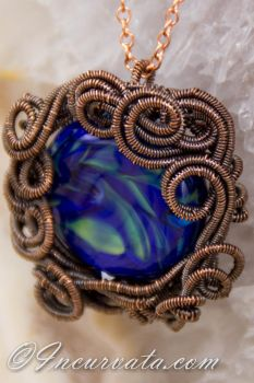 Lampwork in Coils of Wire by youvegotmaille
