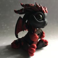 Black and red baby coin dragon.  by BittyBiteyOnes