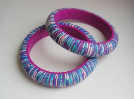 Stropple cane polymer clay bangles by OriginalBunny