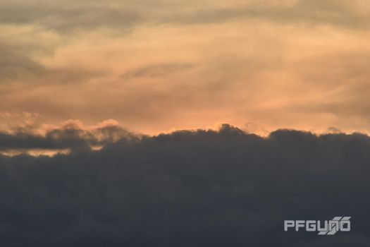 Sunset In The Clouds by pfgun0