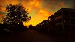 Sunset behind apartements by RedstoneArmy