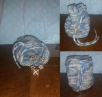 Tan and blue knitted dice pouch by Schorchingskys