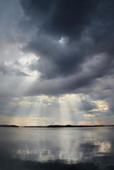 Light rays on a lake by Pajunen
