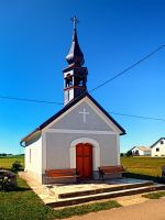 A village chapel with excessive powerlining by patrickjobst