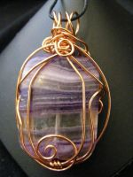 copper wrapped flourite pendant by BacktoEarthCreations
