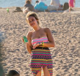 Candid beach girl winking at you by photodeus