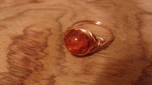 copper wire wrapped amber ring by woodwireandstone