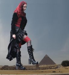 Goddess Amarie crushes another God under her boots by peter2floor