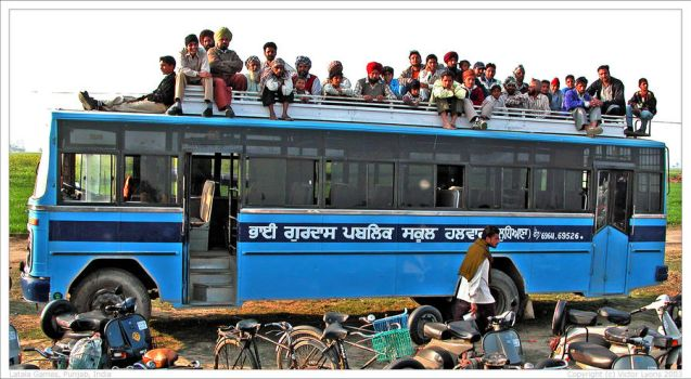 Ludicrously overcrowded bus by VictorInDelhi