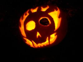 burning skull pumpkin dark by Halfdrake010