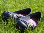 Shoes in the grass by LittleBitOfAlaska