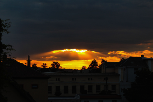 A fiery crack in the clouds. by Nethradorus