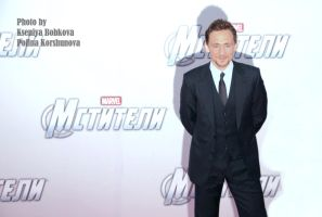 Tom Hiddleston cool as always by GodWitch