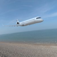 Bombardier CRJ-705 Over the Shore by VanishingPointInc