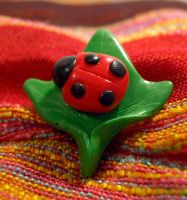 Ladybug on ivy pin by serenainwonderland