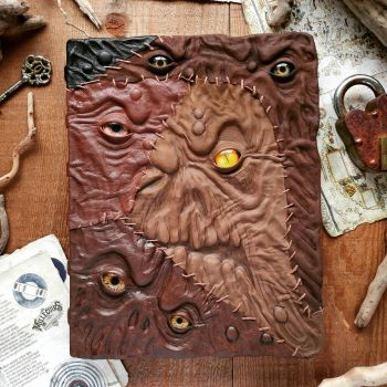 The stitched faces Grimoire by MilleCuirs
