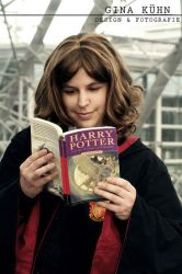 Hermione is reading ... by CuteHermione