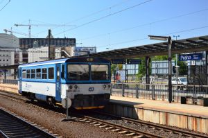 A small diesel railcar at a large terminal by Furuhashi335