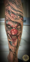 Joker face out of the skin tat by 2Face-Tattoo