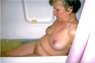 Mature female side view bathing by Seemoramee