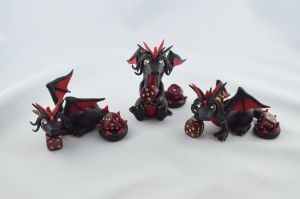 black and red dice dragons by claymeeples