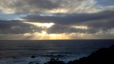 Cloud hidden sun at Pacific shore by shaybee