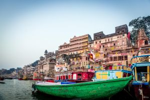 Incredible India - boats at the ghat by Rikitza